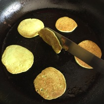 Turning fritters with a palette knife